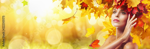 Beautiful High Fashion Woman In Autumn With Falling Leaves Over Nature Background - 222305175
