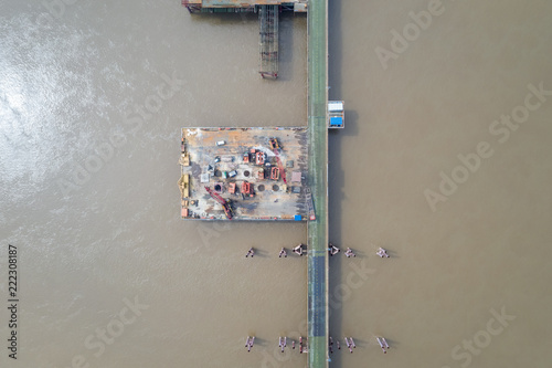Fridge magnet aerial view of bridge construction site