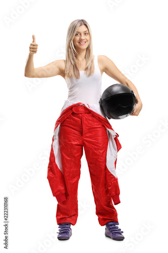 Female race driver holding her thumb up