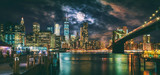 New York City Brooklyn Bridge and Manhattan skyline illuminated at night with full moon overhead. - 222312132