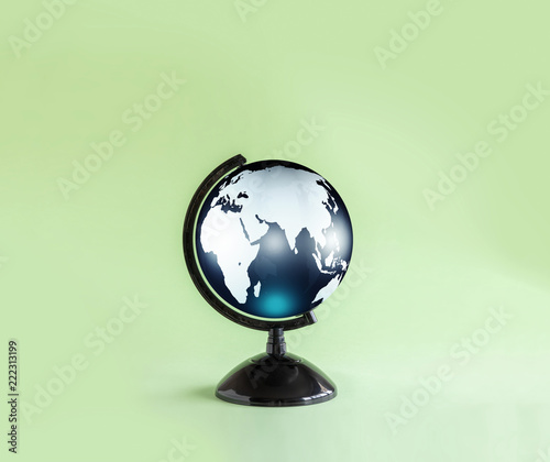 isolated globe model on green background