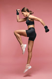 Jump. Sport Woman In Sportswear Jumping On Pink Background - 222315979