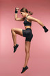 Jump. Sport Woman In Sportswear Jumping On Pink Background