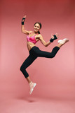 Jump Motion. Smiling Sports Woman Jumping In Sportswear - 222318753