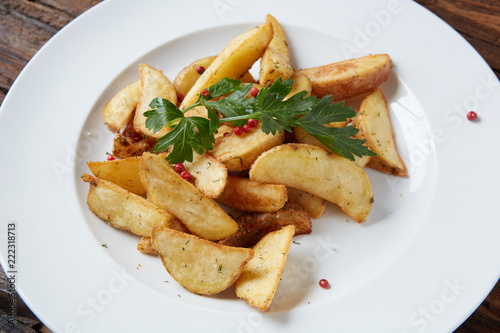Homemade roasted potato with parsley on rustic background. - 222318713