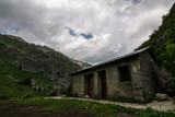 Scenic little cabin in the middle of a vast valley surrounded by mountains. Pyrenees (Huesca, northern Spain) - 222330159