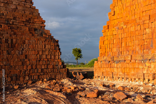 Stacked red bricks, ready for construction - 222341507