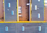 Aerial view of warehouse with trucks. Industrial background. Logistics from above.  - 222354544