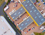 Aerial view of warehouse with trucks. Industrial background. Logistics from above.  - 222354570
