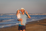 Father with daughter on seashore. Venice, Italy.