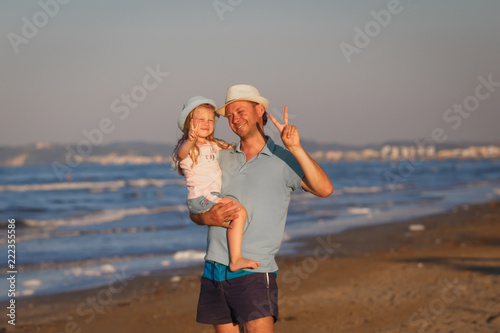 Father with daughter on seashore. Venice, Italy. - 222355586