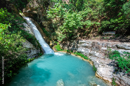 Waterfall in the Neda. The Neda is a river in the western Peloponnese in Greece. Neda is the only river in Greece with a feminine name. It flows into the Gulf of Kyparissia, a bay of the Ionian Sea. - 222355709