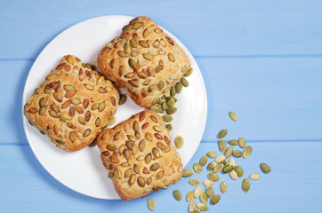 Buns with pumpkin seeds in plate