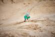 a child climbs a sand hill