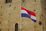 Croatian flag displayed against limestone outer walls - 222374760