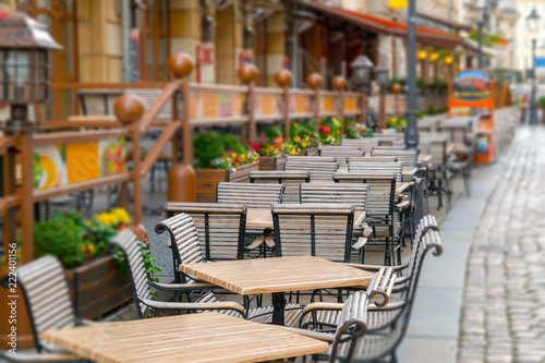 Street view with cafe terrace during the morning in European city
