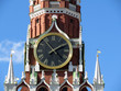Chimes of Spasskaya tower, symbol of Russia on Red Square. Moscow Kremlin tower clock against blue sky