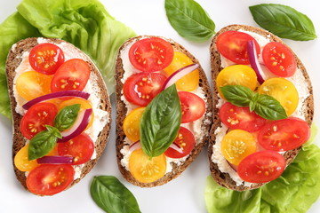 Sandwiches with cheese and tomatoes.