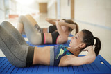 Women doing fitness exercises at the gym