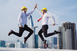 Team engineer jumping when their project is success. - 222449530