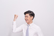 Portrait of happy excited young asian businessman