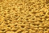 Sandy beach with footprints - 222457140