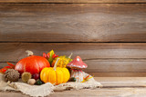 autumnal background before wooden board - 222457707