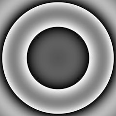 Grauer Ring vor dunklem Hintergrund