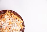plate of macaroni on white background