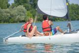 couple having a sailing lesson on a lake - 222483982