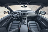 Beautiful view on canyon from modern suv saloon. Car interior with black leather and view on off road panorama.