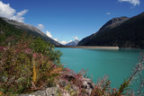 High situated reservoir in Austria with mountains in the background  - 222494925