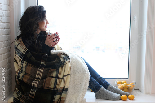 A young woman look on the window - 222498700