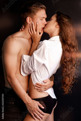 Portrait of young couple in love. Romantic sexy couple over black background. Sensual relations. - 222507351