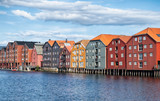 Old colourful wooden warehouses on the river Nidelva in the city of Trondheim, Norway. - 222512375