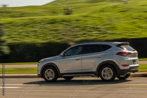 Silver SUV in motion