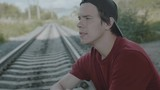 Young thoughtful boy sits on a rail and smokes cigarette. 4K - 222548912