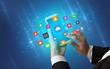 Leinwandbild Motiv Female hand using smartphone with colorful application icons around