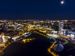 Leinwanddruck Bild - Minsk cityscape at night. Illumination of modern city buildings, aerial top view