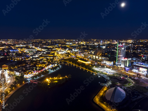 Leinwanddruck Bild Minsk cityscape at night. Illumination of modern city buildings, aerial top view