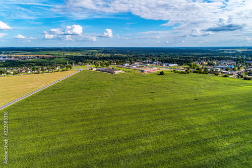 Foto Murales Green agricultural field. View from a great height