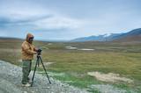 Photographer taking photo on highest mountain