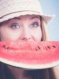 woman holding watermelon fruit