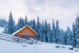 Fantastic winter landscape with wooden house in snowy mountains. Christmas holiday concept. Carpathians mountain, Ukraine, Europe - 222614587