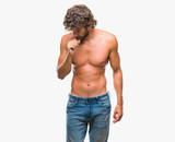 Handsome hispanic model man sexy and shirtless over isolated background feeling unwell and coughing as symptom for cold or bronchitis. Healthcare concept. - 222617324