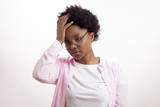 sick woman with a pain in her head. african girl touching her head. afro woman having a splitting headache. female has got a bad head - 222630715