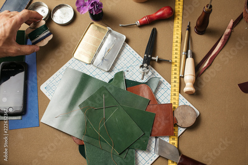 Set Of Leather Craft Tools On Paper Background Workplace For