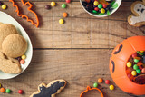Halloween candies on wood table - holiday background - 222639578