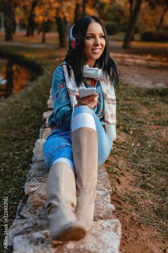 Enjoying Music In The Autumn Park - 222652162
