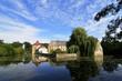 Leinwanddruck Bild - Wasserschloss Tatenhausen mit blauem Himmel und Wolken, NRW, Deutschland, Water castle Tatenhausen with blue sky and clouds, Germany